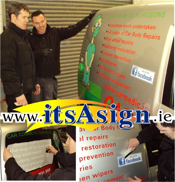 owner and signmaker looking at trademarks and logos applied to company vehicle in dundalk