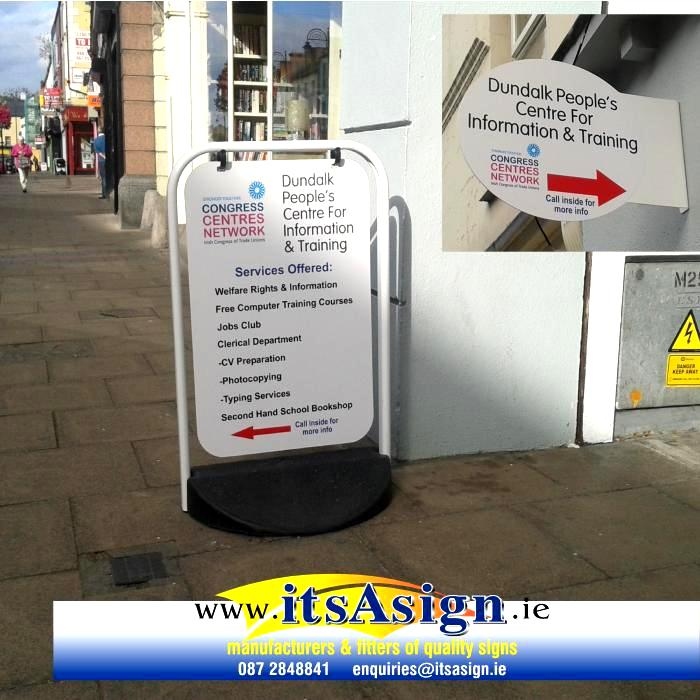 swinger pavement sign on street in dundalk louth
